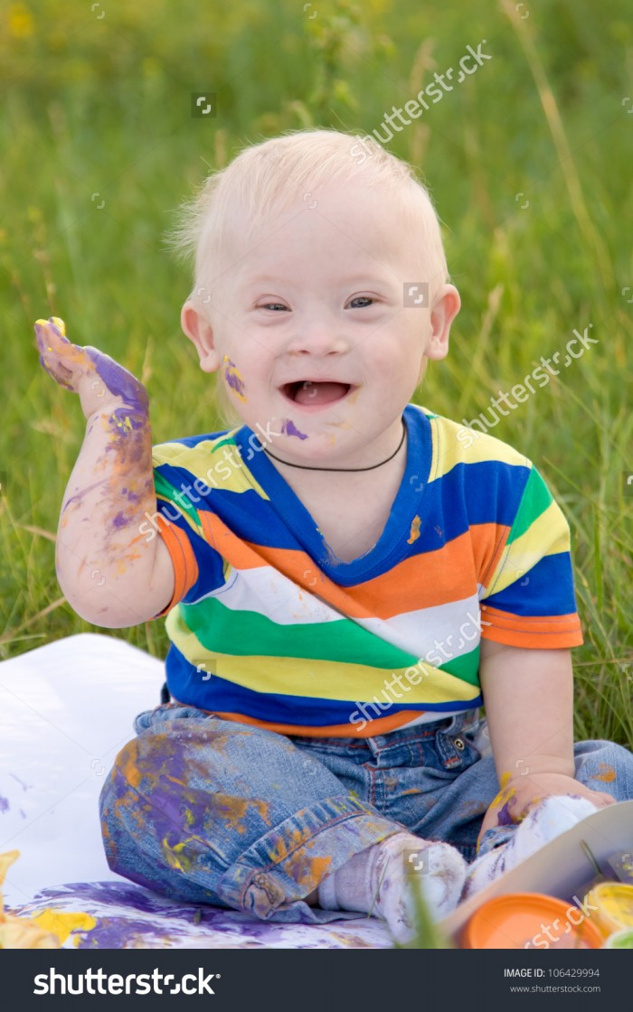 stock-photo-little-baby-boy-with-down-syndrome-painting-finger-paints-on-white-paper-with-a-smile-happiness-is-106429994